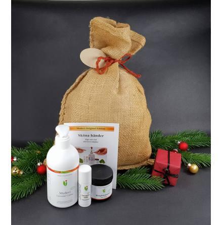Jutesäck eller paket inkl juladress i kvistpapper och snöre.